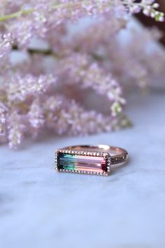 STONE| Stunning Bi-color watermelon tourmaline, emerald cut and set in pave diamonds FINISH |14kt Rose GoldSIZE | 7, one of a kind