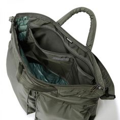 8a4438a124b3 Head Porter 3Way Helmet Bag. Black And Navy ...