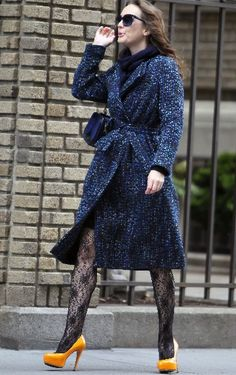 Great from the knee up. Always proud to see Belgian designers on screen!  Dries Van Noten Fall 2011 coat. Oscar de la Renta bag. Brian Atwood shoes.