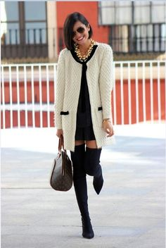 Make a white and black knit open cardigan and a black shift dress your outfit choice for an easy to wear look. A cool pair of black suede thigh high boots is an easy way to upgrade your look.  Shop this look for $212:  http://lookastic.com/women/looks/sunglasses-necklace-over-the-knee-boots-tote-bag-watch-shift-dress-open-cardigan/5242  — Dark Brown Sunglasses  — Gold Necklace  — Black Suede Over The Knee Boots  — Dark Brown Print Leather Tote Bag  — Gold Watch  — Black Shift Dress  — White…