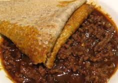 A bowl of Ethiopian Ground Beef Stew with Injera