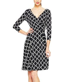 This Black Geometric Wrap Dress is perfect! #zulilyfinds this style flatters all figure types