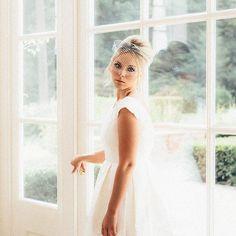 Our Freda dress in silk duchess satin with daisy lace bodice. #weddingdress #weddinginspiration #huntthatdress #madeinengland #vintage