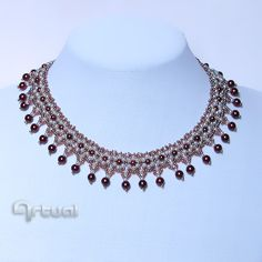 Netted necklace with seed beads and claret pearls