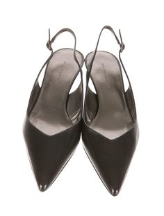 Black Balenciaga leather slingback pumps with pointed toes, covered kitten heels and side buckle closures. Includes box and dust bag.