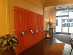 """There's No Writing On Hotel Abri's Ipad Wall - The """"wall"""", which is located in the hotel's lobby, holds five iPads loaded with the latest and best apps out there to help guests tour San Francisco."""