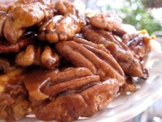 Quick Candied Pecans Servings:  6 2 cups pecan halves 4 tablespoons butter, salted 4 tablespoons brown sugar Directions: 1Melt butter over Medium-High heat. Add pecans and toss to coat. 2 Add sugar, and stir until caramelized. 3 Spread on wax paper and cool.