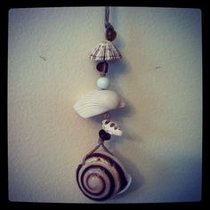 Shell and hemp hanging ornament with brown glass beads $2.00