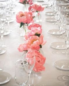 Super simple floral centerpieces. Using less loose florals in low vases atop a fab chevron runner would stretch your dollar and add a lot of perfect!