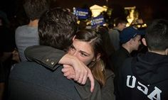 Young Clinton supporters comfort one another outside the White House on election night.
