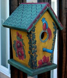 Decorative Birdhouses - Hand painted bird houses, made from solid wood.  via Etsy.