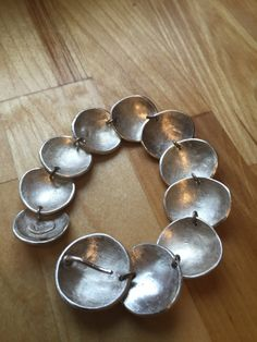 This is a weighty piece! Gorgeous, sculptural hand fabricated sterling silver pebbles are linked together. They overlap beautifully in an