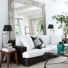 Love the big mirror behind the couch....should make a small room look bigger.