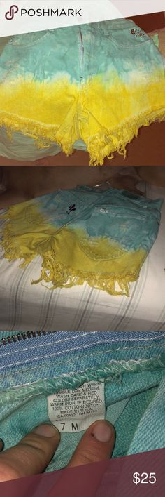 Tye dye high waisted shorts New, rarely worn, size medium high waisted turquoise and yellow high waisted shorts (ALSO ON THE BACK OF THE SHORTS, those are tiny rhinestones u can take off if you want; not a stain!) Lee Shorts Jean Shorts