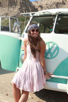 Cute as can be with her road trip ready VW van!