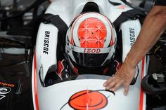 Ryan Briscoe straps in before Saturday's practice at the IZOD IndyCar Series Baltimore Grand Prix.