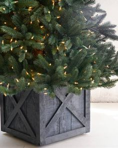 Rustic Grey Wooden Rolling Tree Stand