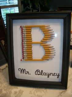 Monogrammed Pencil Art For Your Kid's Favorite Teacher-great to use with a package of cheap Dollar Store pencils and of course pick up a frame at the same time :)