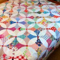 http://www.niftyquilts.blogspot.com/2014/08/flowering-snowball-top-is-done-plus-pin.html