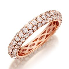 Henri Daussi R3-2 Wedding Ring Henri Daussi shared prong diamond wedding band set in rose gold. Ring features a three-row design of hand-matched fancy light pink natural diamonds. Band is available with diamonds either halfway around or all the way around.