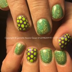 CND shellac gel polish, with fern green holographic glitter & spotty nail art. Short nails.