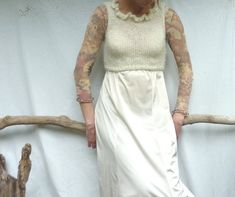 Little Dove Bodice, hand knitted crop top in creamy white Scottish mohair. via Etsy.