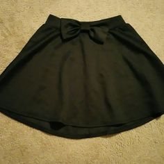 Black skater skirt Black skater skirt with a bow on the front. Stretchy waistband. Brand new. Never worn. No tags. Charlotte Russe Skirts Circle & Skater