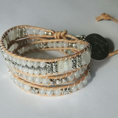 Spirited earth design leather wrap bracelet with rainbow moonstone