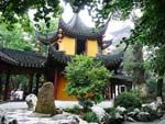 """Hanshan Temple (寒山寺); literally """"Cold Mountain Temple"""", is a Buddhist temple and monastery in Suzhou, China. It is located at the town of Fengqiao (lit. Maple Bridge), about 5 kilometres west of the old city of Suzhou."""