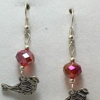 Orange crystal beads and bird charm earrings. Made with silver plated non tarnish hypoallergenic nickel free materials.