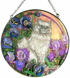 """Amia Painted Stained Art Glass Suncatcher - Persian Cat Irises by Amia. $26.99. Painted brilliant colors.. Measures 6.5"""" in diameter.. Ripple glass.. Chain attached.. To assure the quality of its products, AMIA manufactures its own glass. It is the only company using 'ripple glass,' a natural surfaced textured glass that has a gentle rolling wave appearance similar to cathedral glass. Ripple glass has a majestic appearance, and in-house manufacturing ensures an attractive price p..."""