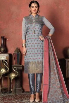Exuding elegance and finished with perfection, this bluish grey banarasi silk trouser suit which will make you absolutely astoundingly gorgeous and that wil be least interesting thing about you. This collar neck and 3/4th sleeve party wear suit beautified with woven and printed work. Dupatta adorned with woven work. #trousersuit #salwarkameez #malaysia #Indianwear #Indiandresses #andaazfashion Pakistani Salwar Kameez, Pakistani Suits, Churidar, Anarkali Suits, Salwar Suits Online, Designer Salwar Suits, Grey Trousers, Trouser Suits, Latest Salwar Kameez Designs