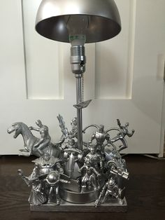 Superhero Lamp. Spray painted action figures attached to a lamp!