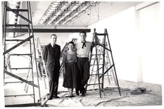 "Alexander Girard with Ray and Charles #Eames while setting up the ""Good Design"" exhibition at the Merchandise Mart Chicago, 1953. Vitra Design Museum, Alexander Girard Estate @hermanmiller @vitra @vitrahaus @dwrpins @hermanmillerbr"