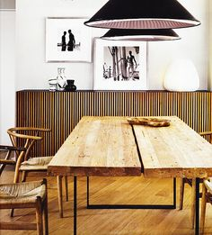 recycled teak wood table, Hans J. Wegner chairs and oversized Tom Dixon pendant lights, nice!