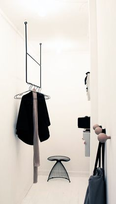 beautiful, minimal clothing racks and hooks. May work well instead of the floor…
