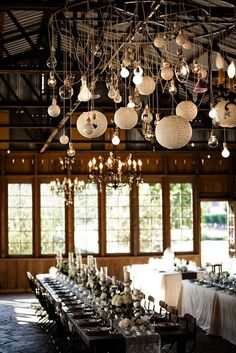 This collection/collage of pendants creates a stunning and unique lighting experience, and is totally fitting of it's wood atmosphere...wish I was dining there tonight.