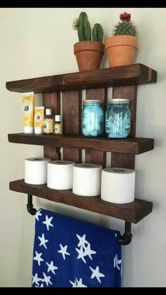 Bathroom shelf and nursery shelf, with pipe towel and baby blanket rack. Store all your bathroom essentials in style with this beautiful dark wood