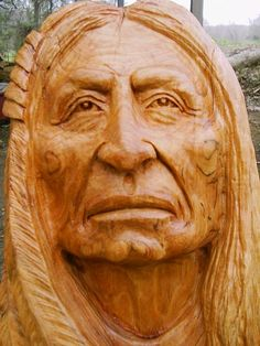 A native american chainsaw carving by Brian Ruth - it's a little big for the… Wood Carving Faces, Wood Carving Patterns, Wood Carving Art, Wood Art, Wood Carvings, Chainsaw Carvings, Native Art, Native American Indians, Native Indian