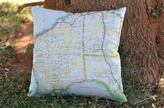 LOVE this idea for the RV! A pillow made from map fabric with red thread stitching of route taken.