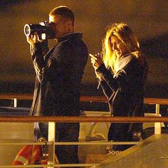 May 26 2004, Brad Pitt and Jennifer Aniston play tourists as they bask in the glow of the Parisian sunset Monday on a romantic boat trip down the Seine River. Aniston was in town visiting her husband, who's filming Ocean's Twelve.