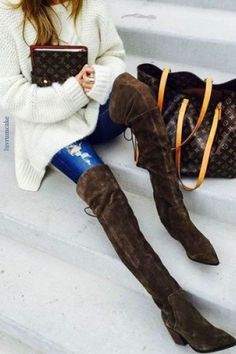 Louis Vuitton totes with a chunky white sweater & distressed skinnies...the brown suede OTK boots steal the look