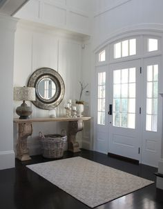 FOYER – great example of an impressive way to welcome guests. Beach style entry by Molly Frey Design.