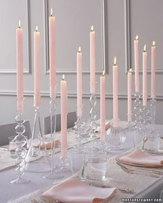In lieu of floral arrangements, display sleek tapers in a variety of shapely glass candlesticks. Inexpensive ones are available at many home-decor stores in lots of styles.