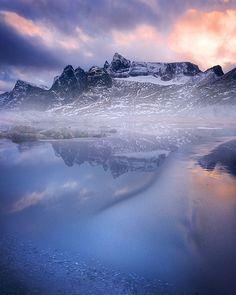 The peaks of Trollveggen (The Troll Wall) over a freshly frozen pond, #Norway