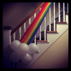 Rainbow party!!! White balloon cloud at the end of streamer rainbow. Daughters 1st bday is the day before St Patricks day so we did a rainbow theme