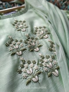 Sweet Pastel Anchor thread zardozi handwork motifs on the front Cotton lace fabric inserts on bottom hem and sleeves . Source by for kurtis Zardozi Embroidery, Embroidery On Kurtis, Hand Embroidery Dress, Kurti Embroidery Design, Embroidery Flowers Pattern, Couture Embroidery, Flower Embroidery Designs, Embroidery Motifs, Simple Embroidery