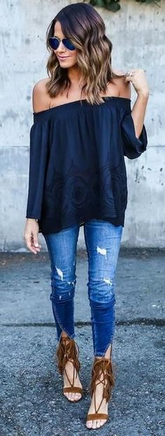 Navy off-the-shoulder top, jeans and sandals.