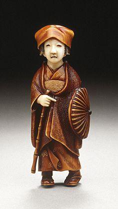 Minkoku III (Japan)  Female Traveler, late 19th-early 20th century  Netsuke, Ivory with dark staining, sumi,