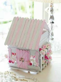 FAIRY COTTAGE BY THE SEA http://suchprettythings.typepad.com/my_weblog/2014/03/seaside-tinkered-treasures-my-interview-with-elyse-major.html When I think of Popsicle stick projects, I'm propelled back in time to summer camp where the ubiquitous Popsicle stick bird house... napkin holder... hot plate... were fashioned. When I grew up, it occurred to me that they had all mysteriously disappeared without fanfare. I wonder what was the official number of days my mother felt compelled to display…
